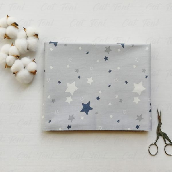 Звёзды разных размеров на сером хлопок купить